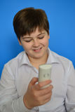 Boy teenager dials the number on  radiotelephone Royalty Free Stock Image
