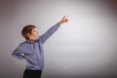 Boy teenager European appearance Dark Brown shows Royalty Free Stock Image