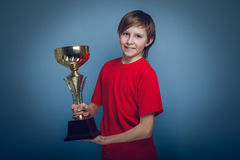 Boy teenager European appearance in a red shirt Stock Photo