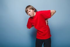 Boy teenager European appearance in a red shirt Stock Image
