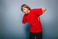 Boy teenager European appearance in a red shirt Royalty Free Stock Image