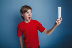 Boy teenager European appearance in a red shirt a Royalty Free Stock Photography