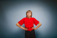 Boy teenager European appearance in a red shirt Stock Images
