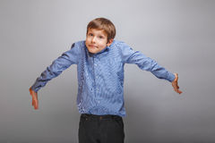 Boy teenager European appearance spread his arms, Stock Image