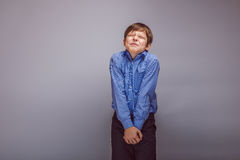 Boy teenager European appearance winced from pain royalty free stock photos