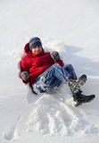 Boy Teenager Falling in the Snow. In winter Stock Image