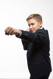 Boy teenager gentleman in a suit royalty free stock image
