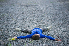 Boy teenager lying on a chalk dreaming Stock Photos