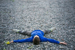 Boy teenager lying on a chalk dreaming Royalty Free Stock Image