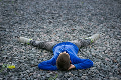Boy teenager lying on a chalk dreaming Stock Images