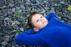 Boy teenager lying on a chalk dreaming Stock Photo