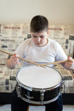 Boy teenager playing drums in  room Royalty Free Stock Images