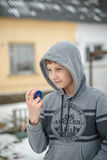 Boy the teenager plays with the yo-yo on the street Stock Photography