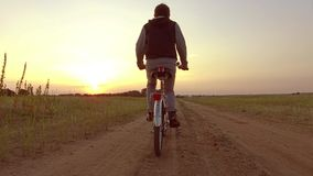Boy teenager riding a bicycle. Boy teenager riding a bicycle goes to nature along the path steadicam video shot motion