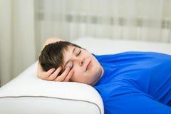 Boy teenager sleeping on anatomic pillow. Boy teenager sleeping on an anatomic pillow royalty free stock photos