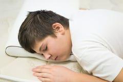 Boy teenager sleeping face down on anatomic pillow. Boy teenager sleeping on an anatomic pillow royalty free stock image