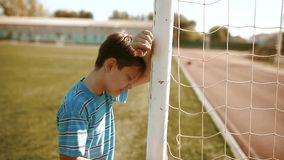 Boy teenager soccer football player upset defeat insult sadness and anger. boy teenager grieved after the defeat, well