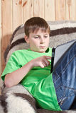 Boy teenager with tablet computer Royalty Free Stock Photography