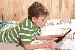 Boy teenager with tablet computer Royalty Free Stock Images