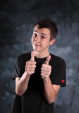 Boy teenager thumbs up Stock Photos