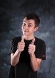 Boy teenager thumbs up Stock Photos