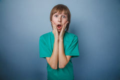 Boy, teenager, twelve years in a green shirt Royalty Free Stock Photos