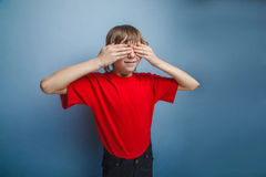 Boy, teenager, twelve years in  red T-shirt, eyes Royalty Free Stock Photo