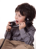The boy with a telefone Stock Photography