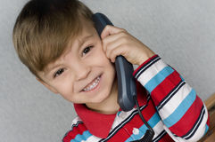 Boy with telephone Royalty Free Stock Photos