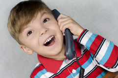 Boy with telephone. Communication - Portrait of little child in T-shirt talking to an telephone Stock Image