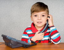 Boy with telephone Royalty Free Stock Image