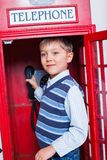 Boy with telephone Stock Images