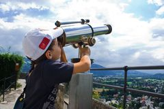 Boy with telescope Royalty Free Stock Image