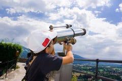 Boy with telescope. Boy with cap looking through a telescope near Salzburg, Austria Royalty Free Stock Photos