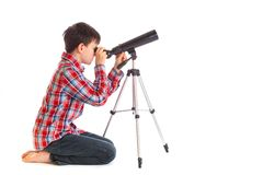Boy with telescope. A Boy is looking through telescope isolated over white background
