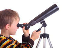 Boy with telescope royalty free stock photo