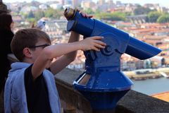 Boy and telescope royalty free stock image