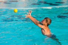 Boy with tennis ball stock photo