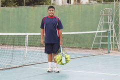 Boy with tennis balls Stock Photo