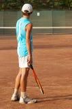 Boy on tennis court stock photo