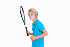 Boy with tennis racket in front of white background Royalty Free Stock Image