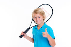 Boy with tennis racket and thumb up in front of white backgroun Stock Photo