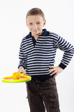 Boy with a tennis racket. On white background Stock Images