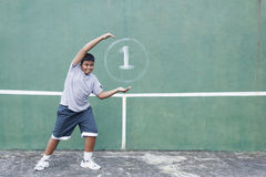 Boy and Tennis wall Royalty Free Stock Image
