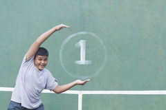 Boy and Tennis wall Stock Photo