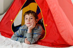 Boy in a tent Royalty Free Stock Photos