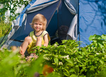 Boy about tent Royalty Free Stock Photo