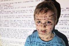 Boy an text projection device Stock Photos