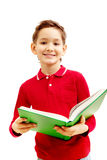 Boy with textbook. Image of cheerful little boy holding the textbook Stock Image