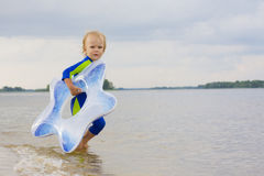 Boy of 2th years old playing near water Royalty Free Stock Photos